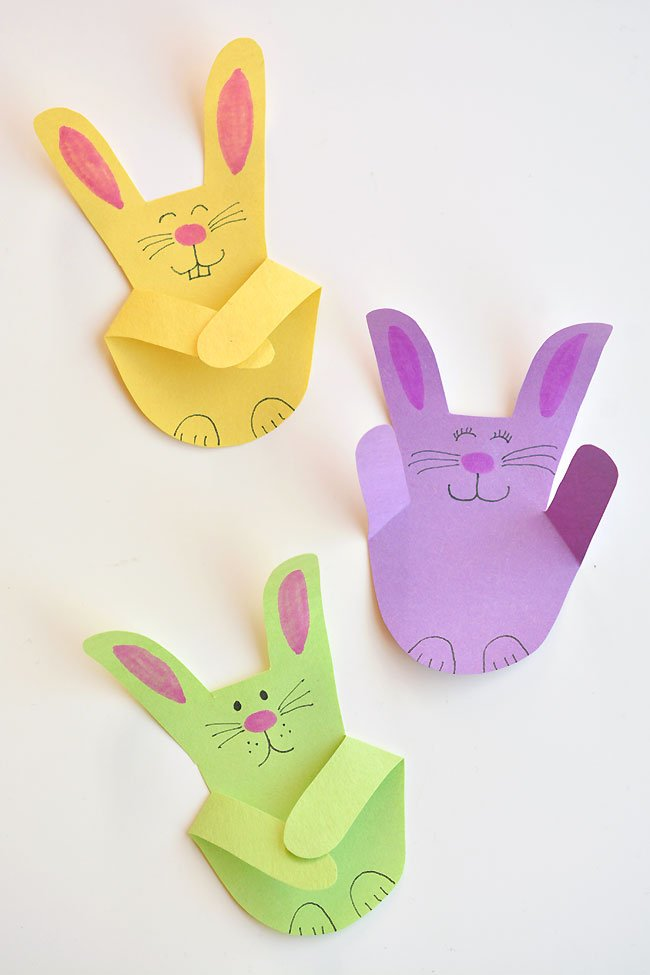 handprint bunny easter arts and crafts idea displayed on a table