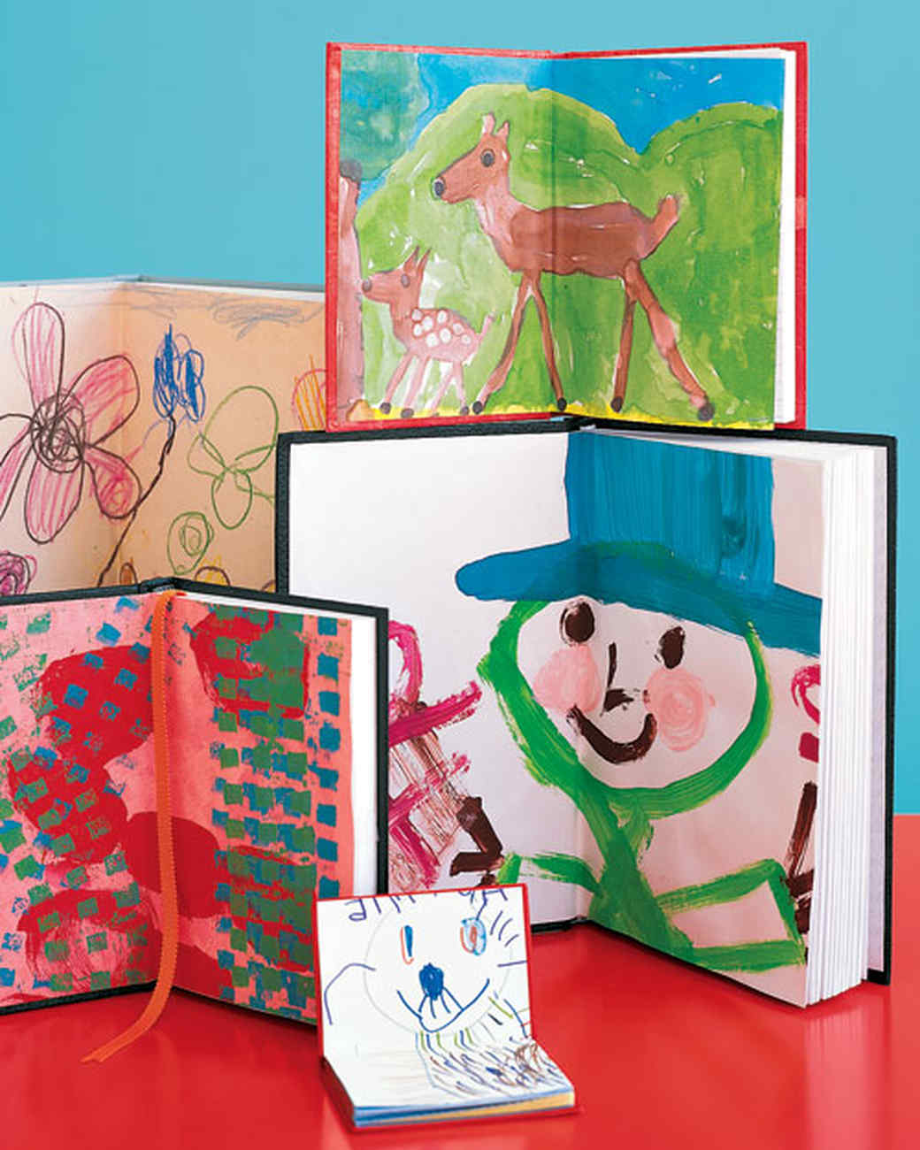 kids artwork inside the front and back covers of various arranged journals