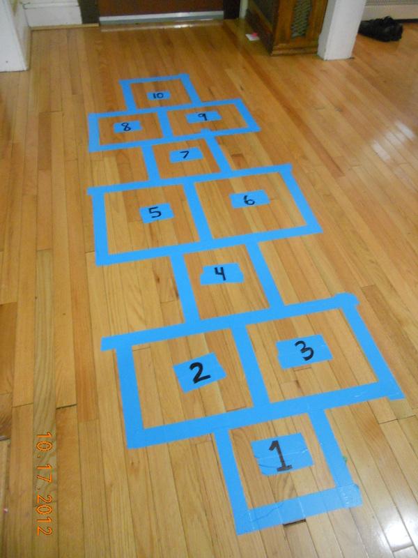blue tape indoor hopscotch for kids