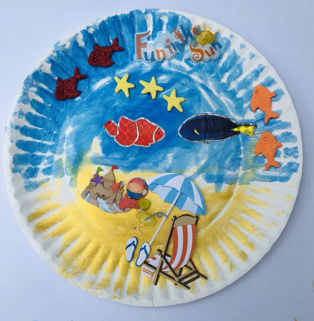 paper plate beach craft made with markers and stickers