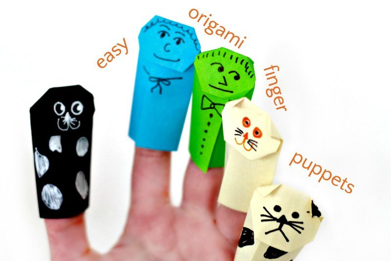 the indoor kids activity that is made out of paper - origami finger puppets in different colors and shapes on a hand