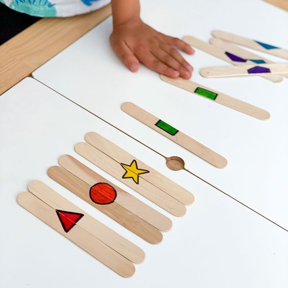 Matching shape puzzles made out of craft sticks for toddler busy bags