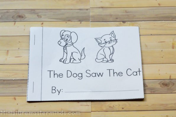 """printable sight word book called """"the dog saw the cat"""" on a table"""